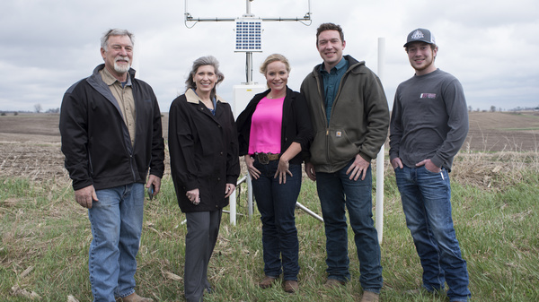 sen ernst and others in front of weather sensor