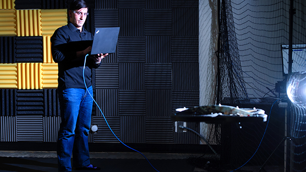 calvin with laptop in front of drone